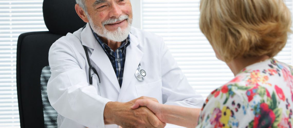 30529473 - doctor shaking hands to patient in the office
